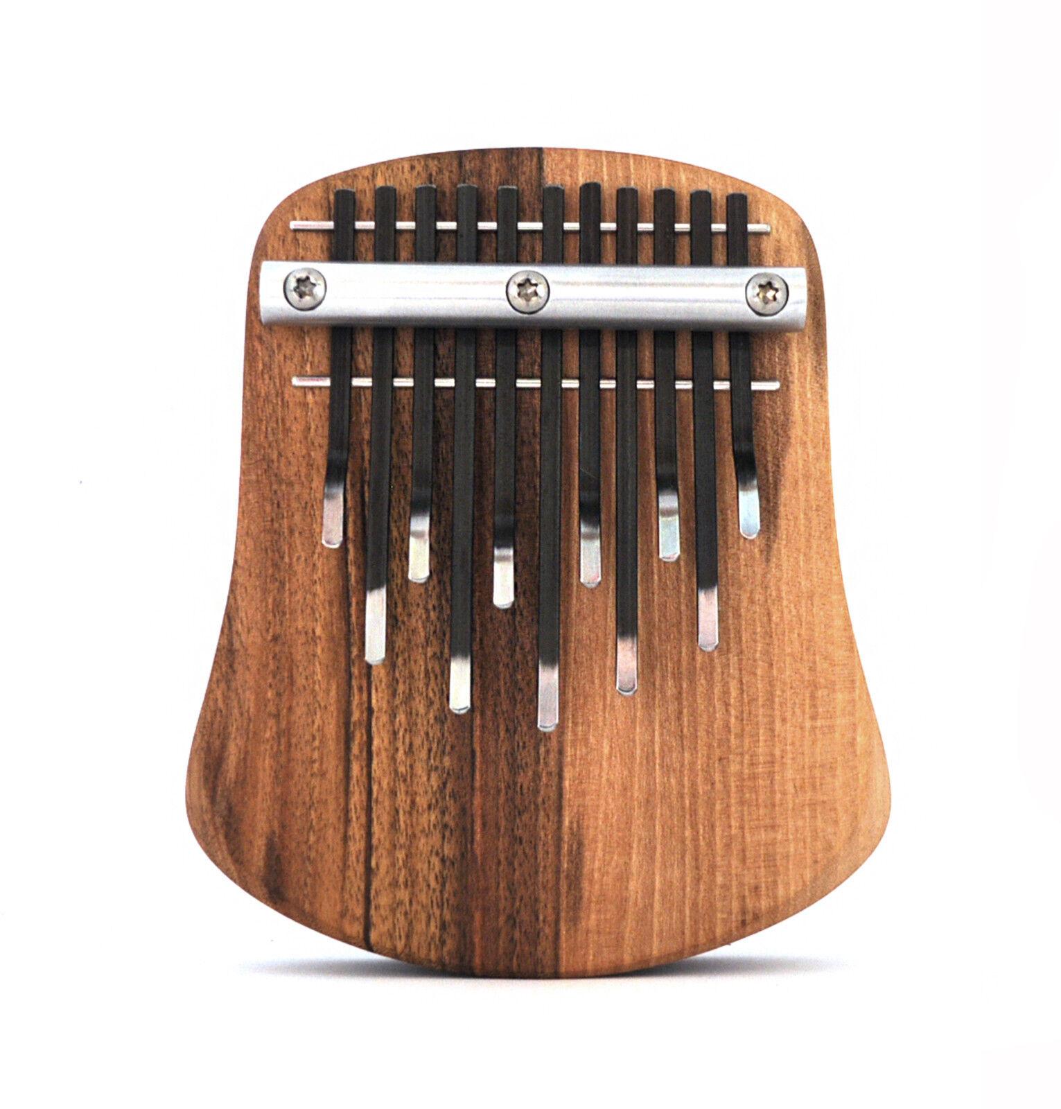 Thumb piano - 11 tone kalimba PYRA on the resonance desk in pentatonic tuning