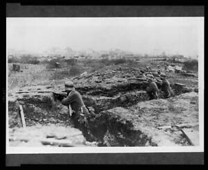 Photo:German soldiers in a trench,town,WWI,1914-1918,guns ...