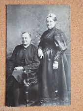 R&L Postcard: Edwardian Portrait Man Woman Vicar Black Mourning Dress?