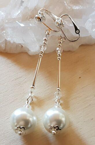 Orejas clips Lang perlas rosa color plata