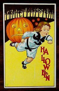 Halloween BOY RUNS FROM FROWNING JACK O'LANTERN J.E.B. Postcard Series 57E 1914