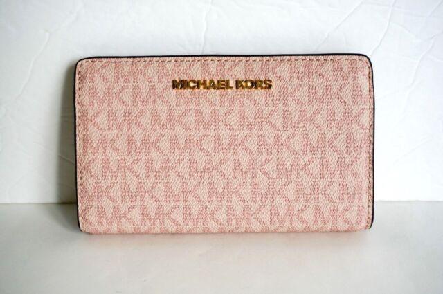 ba3c9c189147 ... reduced michael kors jet set travel pvc slim bifold wallet fawn mk  ballet pink 3029e 34804