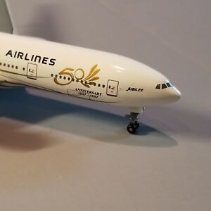 DRAGON-WINGS-SINGAPORE-034-JUBILEE-034-777-200-1-400-SCALE-DIECAST-METAL-MODEL