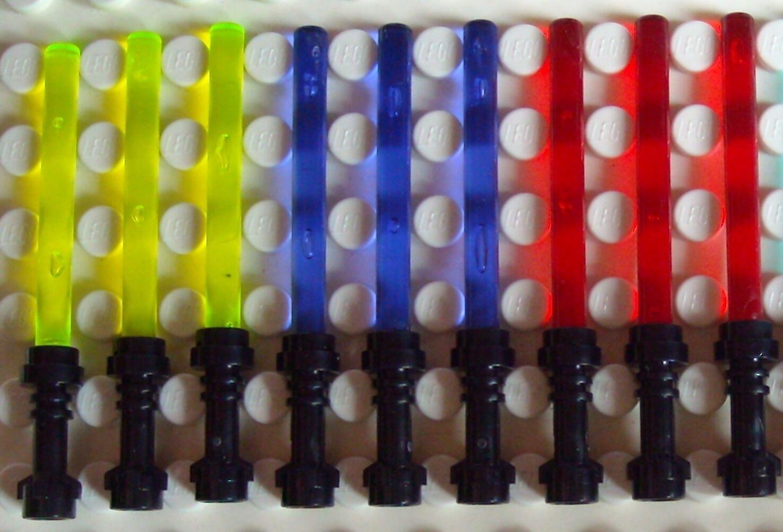 10 Lego Laserschwerter schwarzer Griff in gelb lila für Star Wars Minifiguren