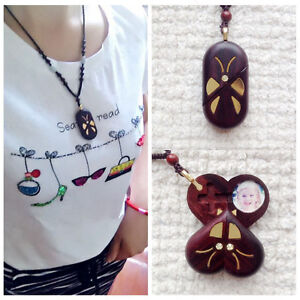 The illusionist necklace wood locket butterfly pendant necklace image is loading the illusionist necklace wood locket butterfly pendant necklace aloadofball Image collections