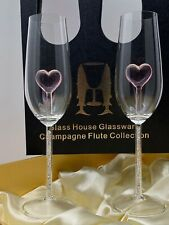Two Heart Champagne Flutes™ with Swarovski™ Crystals in the Stem in a Beautiful