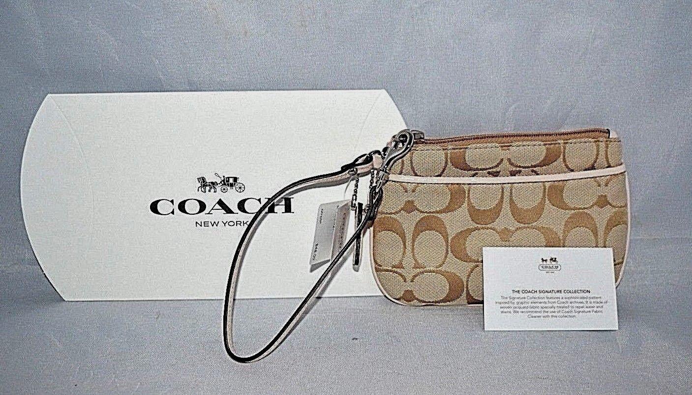 95df17c89973 Coach Signature Khaki With Blush Trim Small Wristlet F45659 for sale ...
