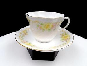 "ROYAL DOVER EMBOSSED SWIRL PINK AND YELLOW FLOWERS 2 1/2"" CUP AND SAUCER SET"