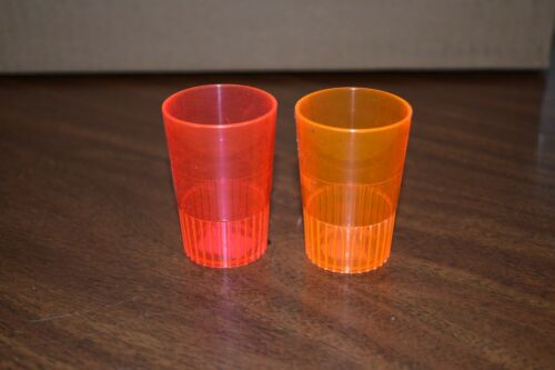 Old pair plastic collectible shot glasses pink & orange