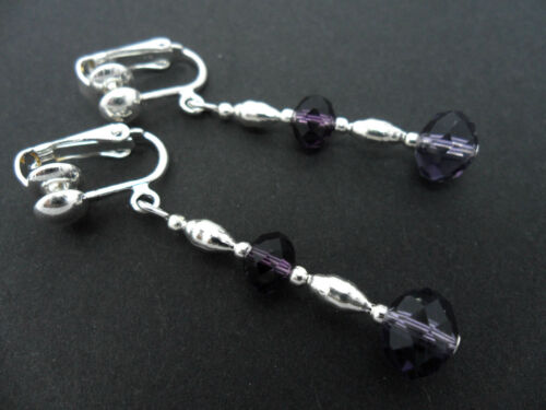 A PAIR OF PURPLE CRYSTAL  SILVER PLATED  CLIP ON EARRINGS.