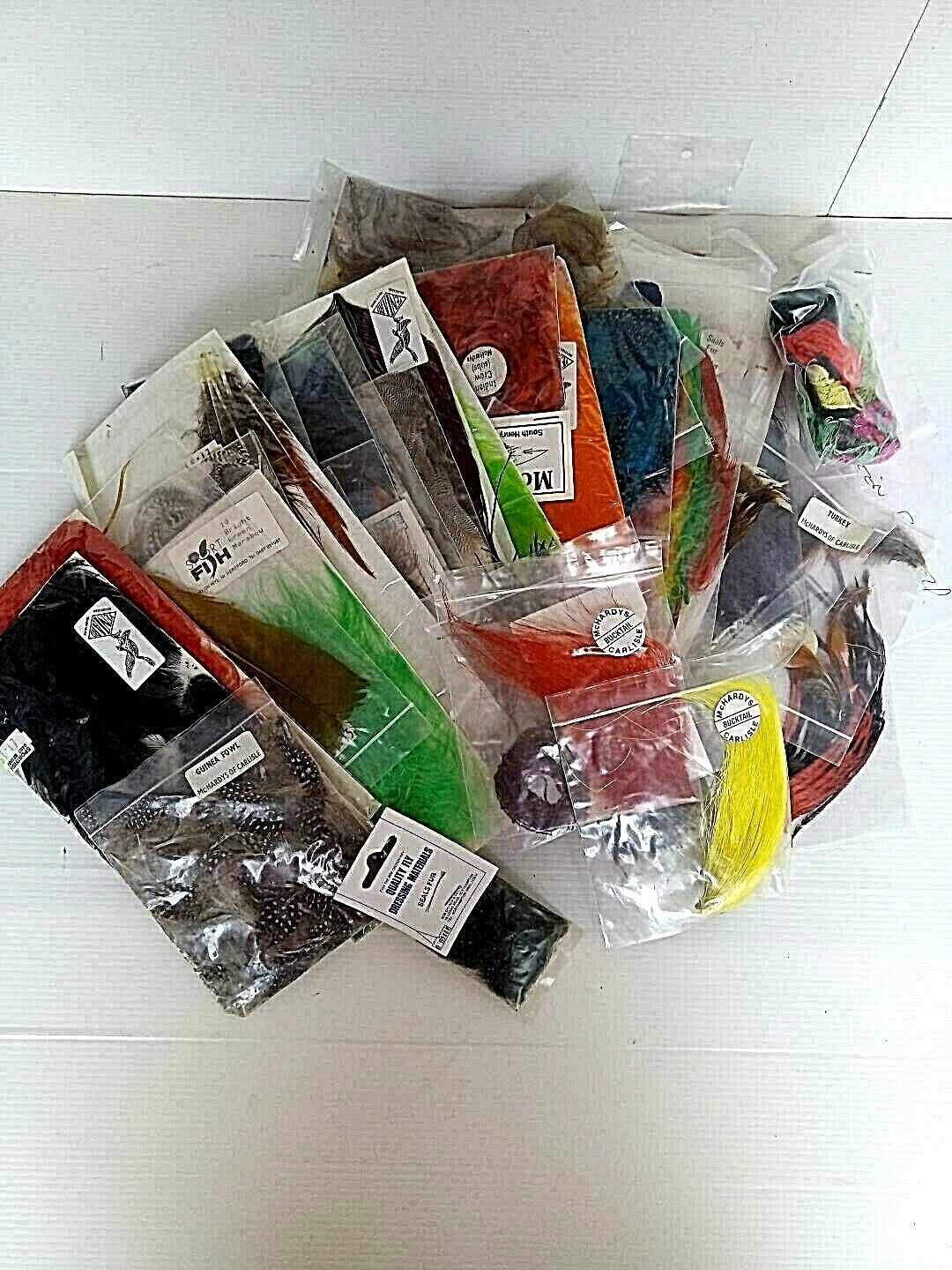 Fly tying selection of feathers, yarns etc. Still in original purchased packets.