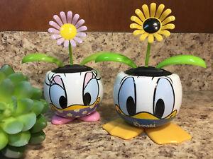 Details about Disney Parks Daisy Duck \u0026 Donald Duck Flower Pot w/Solar Powered Dancing Flower & Disney Parks Daisy Duck \u0026 Donald Duck Flower Pot w/Solar Powered ...