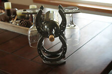 Horseshoe wine rack holds two bottles and two glasses