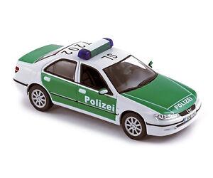 Peugeot-406-Polizei-1-43-NOREV