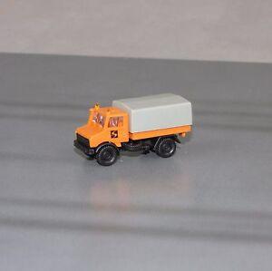 Mercedes-Benz-Unimog-Strabag-LKW-mit-Plane-Bau-Neu-ohne-OVP-Spur-N-1-160-ROCO