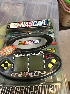 BRAND-NEW-NASCAR-SUPERSPEEDWAY-HANDHELD-LCD-GAME-MULTI-SCREEN