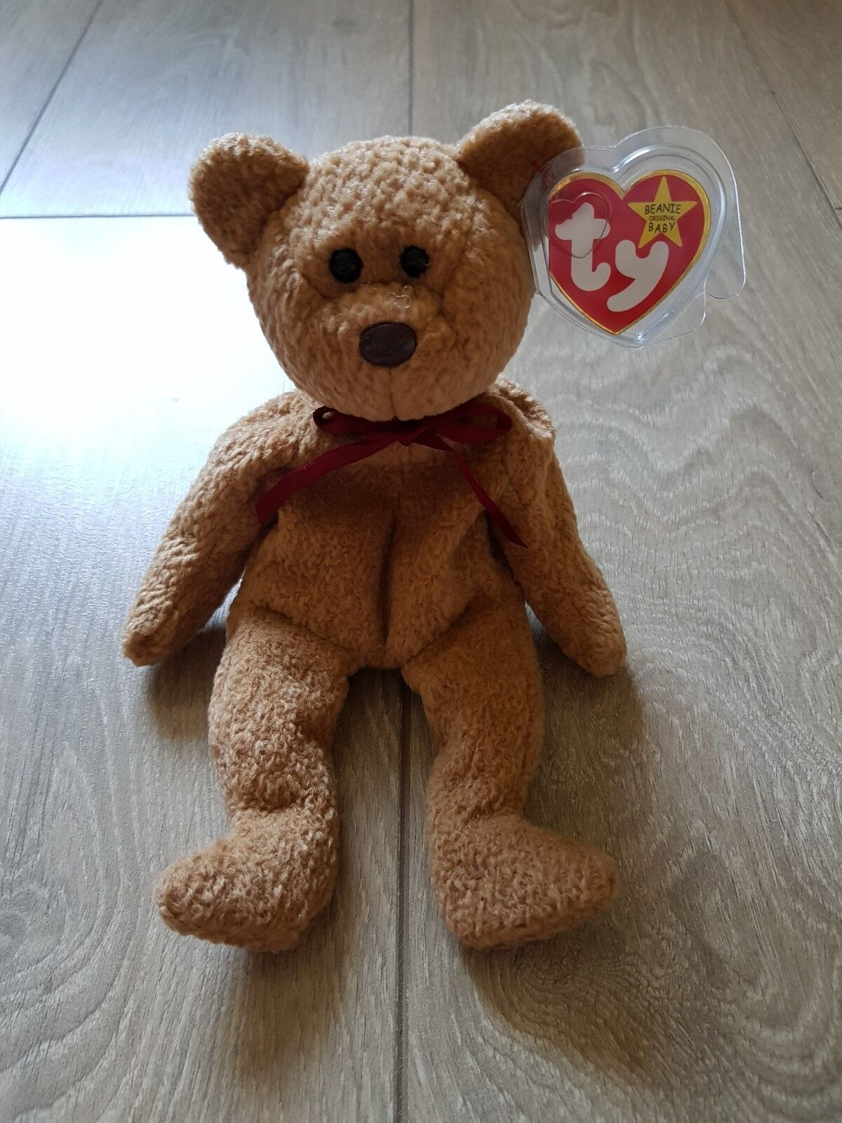 Ty beanie baby 'CURLY' the bear. 1993, has a  RARE  red stamp  in tush tag.