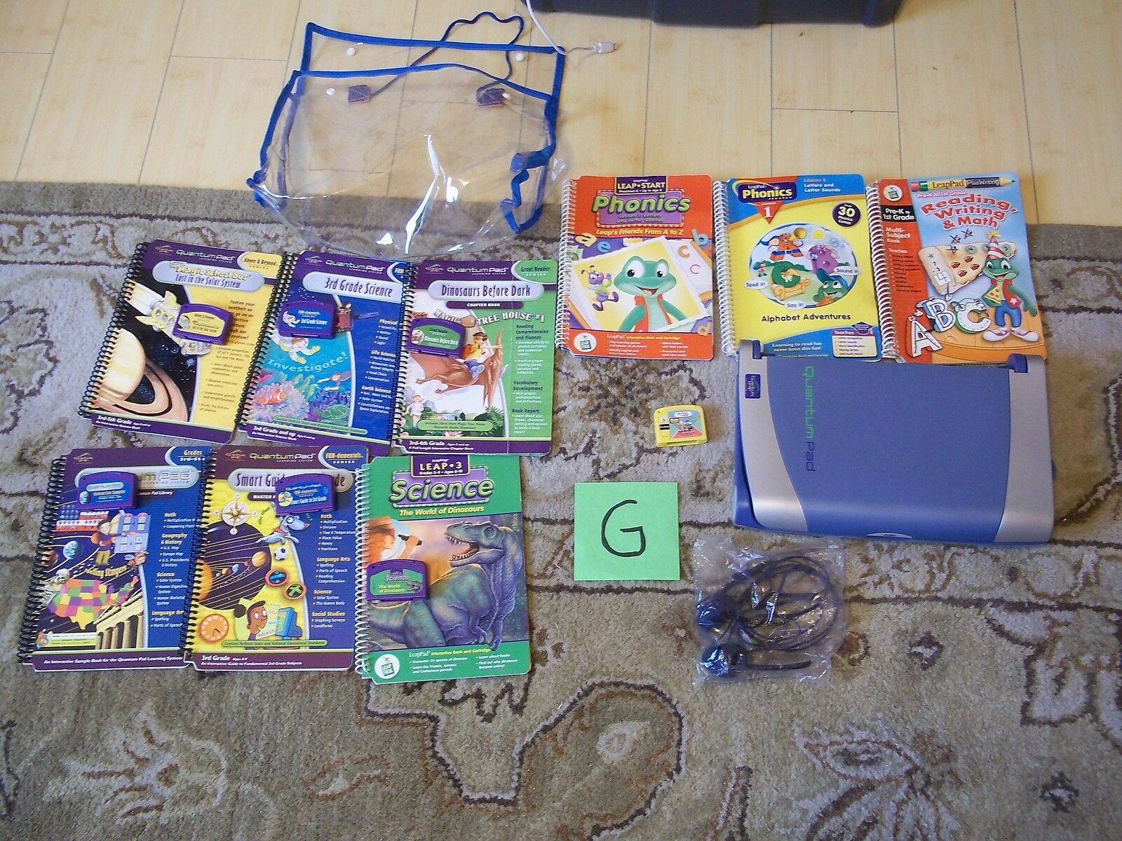 QUANTUM PAD LEARNING SYSTEM W 9 BOOKS 7 CARTRIDGES HEADPHONES & CARRY CASE