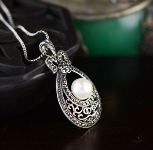 B09 Anhänger Schleife Tropfen weiße Perle und Markasit Sterling Silber 925