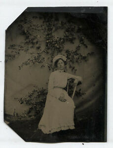 tintype woman casual pose butterfly pinfabric backdrop