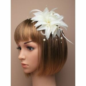 White cream fascinator with flower and bead detailing