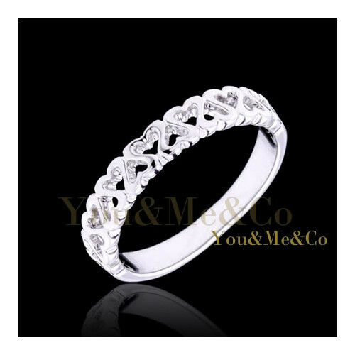 18k White Gold EP String Of Hearts Band Ring