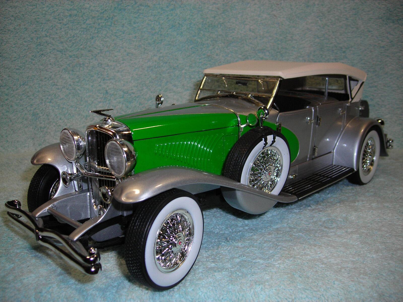1 18 1934 Duesenburg 4DR. Cabrio En Plata verde \ \ top blancoo de la firma.