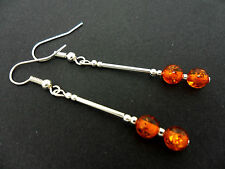 A PAIR OF SILVER PLATED AMBER GLASS BEAD DANGLY EARRINGS. NEW.