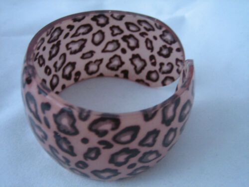 bangle type bracelet in animal print plastic various shades 4 cms wide
