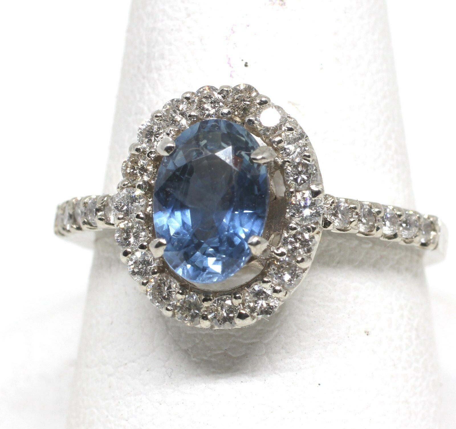 bluee sapphire surrounded by diamonds 14kw gold size 6