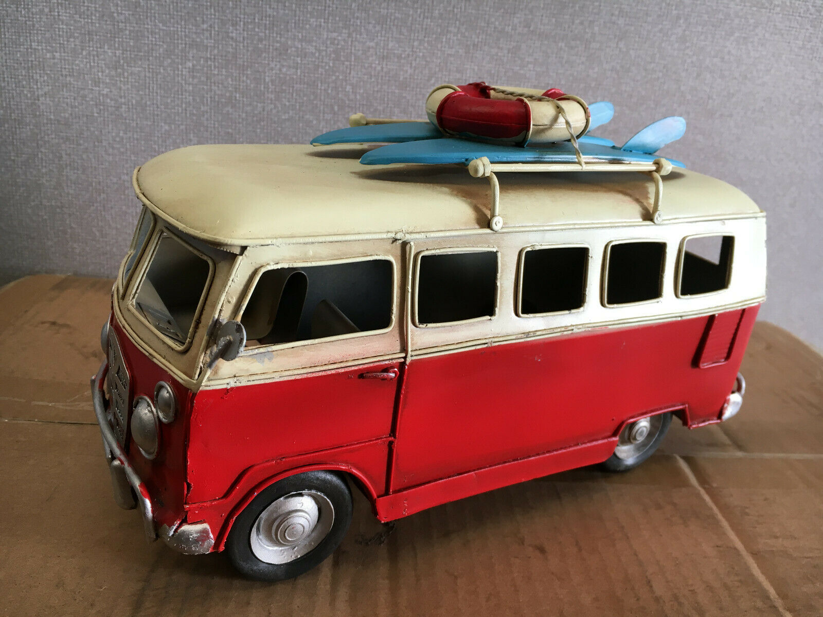 Red Tin Vintage Camper Van With Surf Boards and Life Saving Ring Model