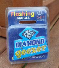 flashing pin badge/ fridge magnet new in original pack. 'DIAMOND GEEZER'