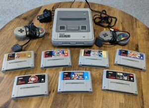Super Nintendo SNES Consoles • 7 Games • 2 Controllers And Cables