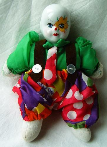 Vintage old clown toy doll porcelain head very nice