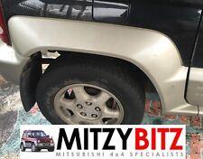 Mitsubishi Montero Junior Mini OSR controladores parte trasera derecha Rueda Arch Trim Fender