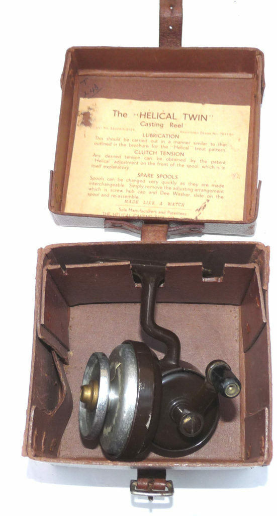 Vintage Helical Twin threadline casting reel in brown  with half bail & box  low-key luxury connotation
