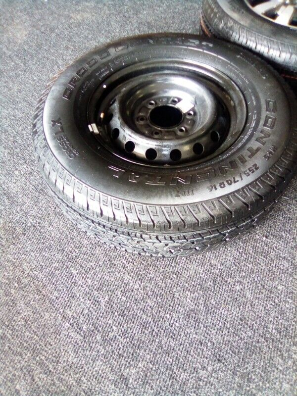 """16"""" Ford Ranger steel rim with 255/70/16 used tyre to use for spare R750."""