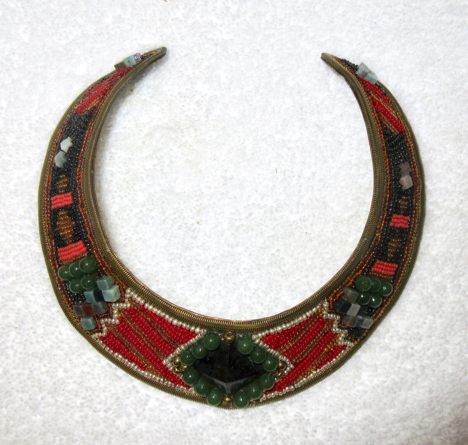 Big beaded copper neck plate with large synthetic beads and metallic threading by M /& J Hansen.