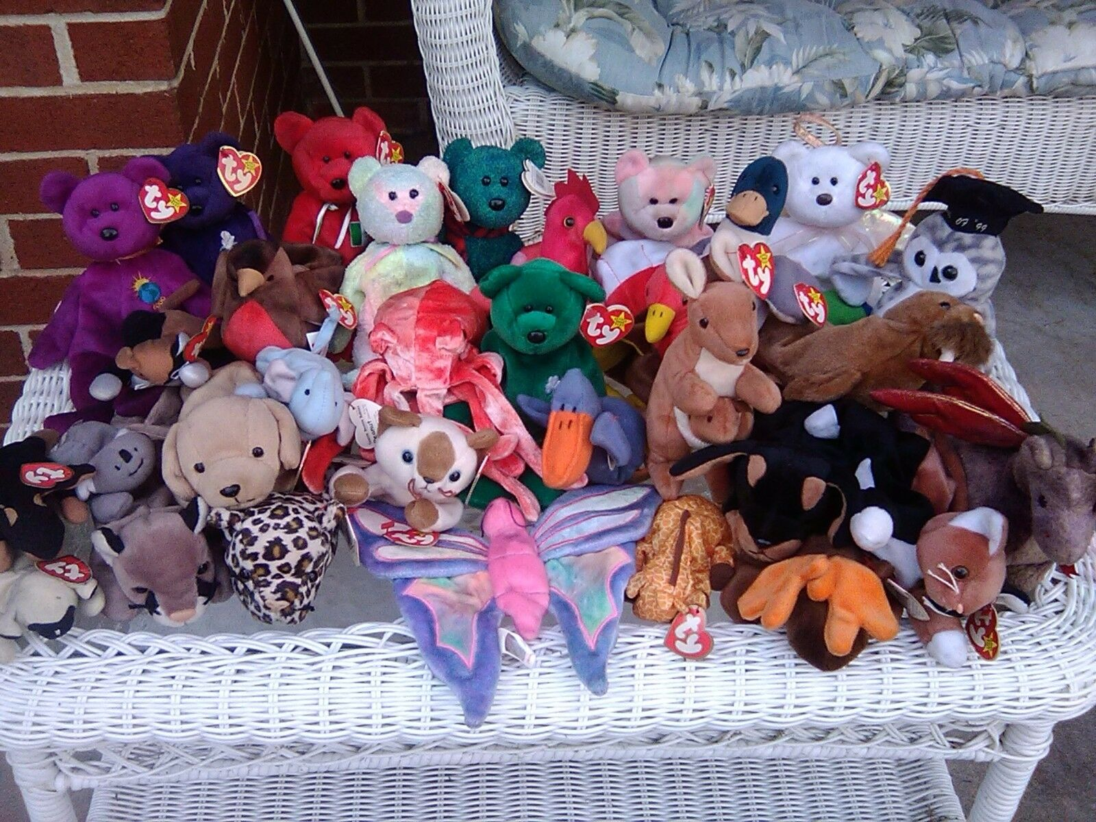 Lot of 33 TY 1997 beanie babies including Wiggly the octopus, Princess Diana