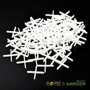100 x plastic cross tile spacers tombstone style 1 10mm for 10mm floor tile spacers