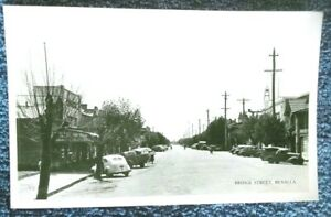 1950-039-s-postcard-Bridge-St-Benalla-Victoria-vintage-motor-cars-shopping-centre