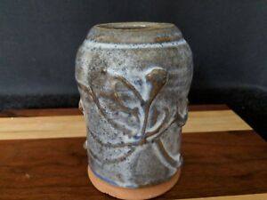 Vintage pottery jar with carved low relief oriental characters