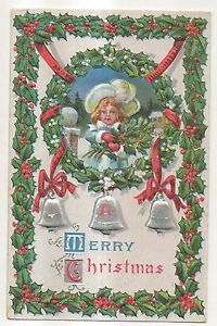 A-Merry-Christmas-Girl-with-Fancy-Hat-and-Flowers-Wreath-Vintage-Postcard
