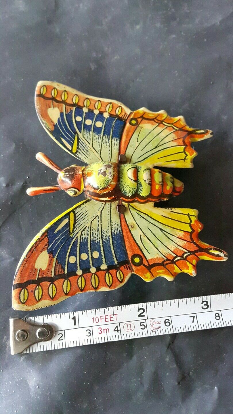 VNTG. TIN TOY BUTTERFLY METAL RUBER FRICTION POWErosso MECHANICAL GERMANY GDR USSR