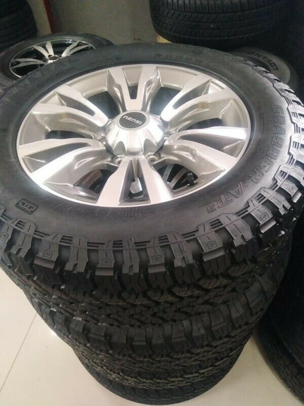 """18"""" Isuzu X-Rider original mags with brand new 255/60/18 General Grabber AT3 set for R14000."""