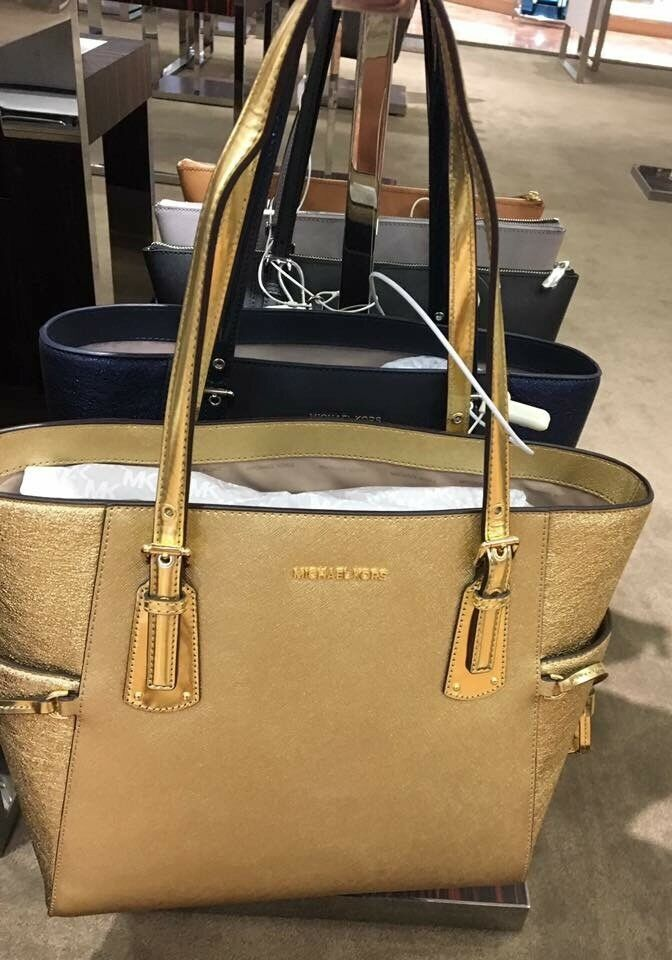 ffa7962197e0eb Michael Kors Voyager East West Signature Tote Handbag Gold 100 ...