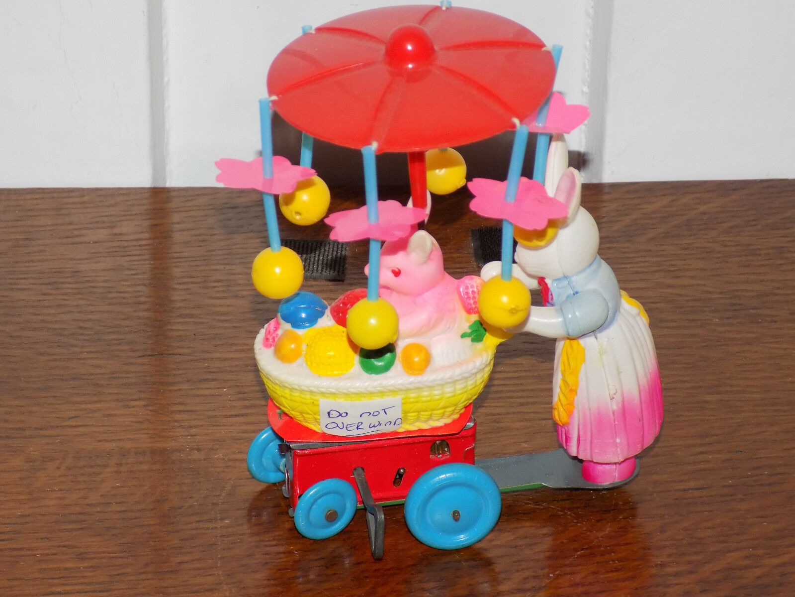 Celluloid Bunny Carriage Wind Up Toy