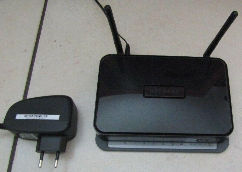 Netgear Wireless-N 300 Modem Router DGN2200 with Power Supply