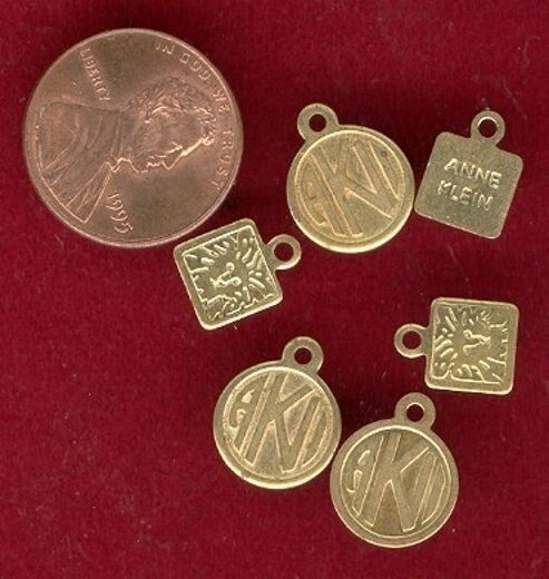 24 PIECES BRASS ANNE KLEIN ASSORTED STAMPED TAG CHARMS    T149