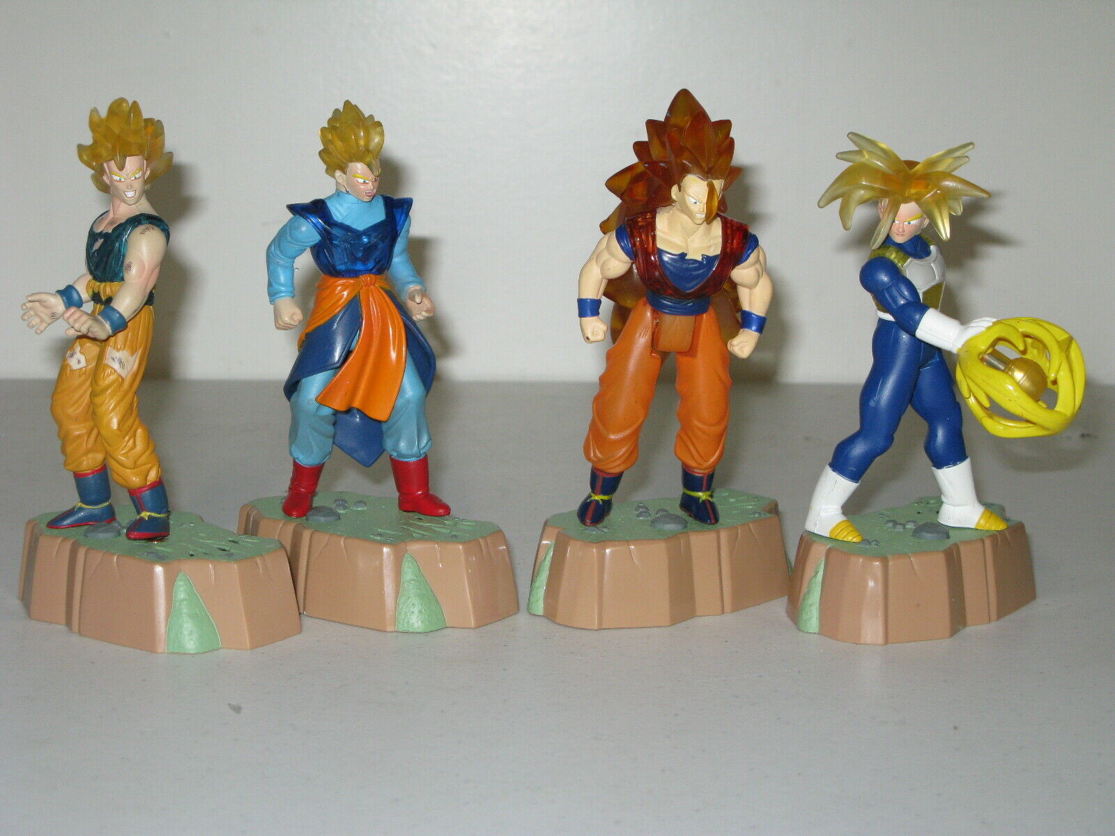 4 Dragon Ball Z Energy Glow Super Sayan Goku Vegeta Trunks Gohan Jakks + Stands